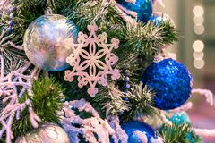 Christmas ornament ball for Xmas New Year festival decorate on pine tree background Royalty Free Stock Photo