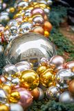 Christmas ornament balls. Bright balls of christmas ornament, reflection of buildings stock image