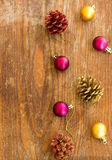 Christmas ornament with balls on wooden background Stock Image