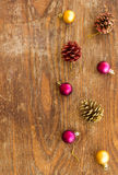 Christmas ornament with balls on wooden background Stock Photos