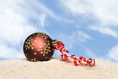 Christmas ornament on beach Stock Images