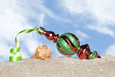 Christmas ornament on beach Royalty Free Stock Image