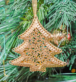 Christmas ornament, bell, globe hanging, sparkles, snow flake, gold, merry christmas, green tree Royalty Free Stock Photos