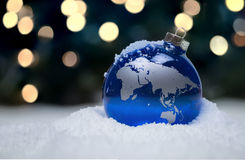 Christmas Ornament. A blue Christmas ornament sits in the snow Stock Photography
