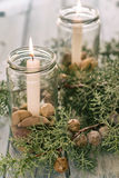 Christmas ornament. With burning candles and juniper berries Stock Image