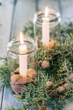 Christmas ornament. With burning candles and juniper berries Royalty Free Stock Images