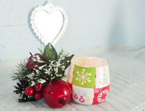 Christmas ornament and candle Stock Images