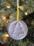 Christmas ornament 2. A close up of a home made christmas ornament with a hole punched christmas tree Stock Photography