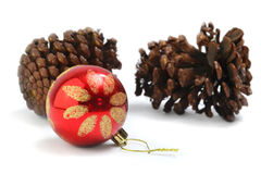 Christmas ornament and conifer cones Royalty Free Stock Photography