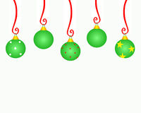 Christmas Ornament Copyspace. Christmas ornaments hanging from red curly ribbons Stock Photography