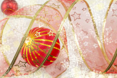 Christmas ornament and decorative shiny red tape Stock Photography