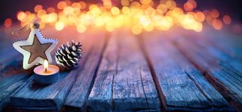 Christmas Ornament On Defocused Table. And Bokeh Lights stock images