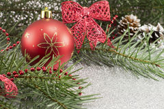 Christmas ornament and fir tree on shiny background Royalty Free Stock Photography
