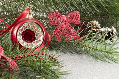 Christmas ornament and fir tree on shiny background Stock Photo
