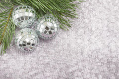 Christmas ornament and fir tree on shiny sparkling background Stock Photo