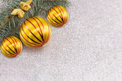 Christmas ornament and fir tree on shiny sparkling background royalty free stock photos