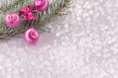 Christmas ornament and fir tree on shiny sparkling background royalty free stock images