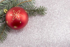 Christmas ornament and fir tree on shiny sparkling background Stock Image