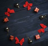 Christmas Ornament Formed Circle on Black Wooden Texture. Top Vi. Ew royalty free stock photos