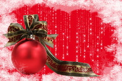 Christmas Ornament with Frosty Border. A red glass Christmas ornament with green and red flocked ribbon, red background with stars and frosty snowflake border Royalty Free Stock Image