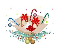 Christmas Ornament in Gift Boxes on Fir Twigs Royalty Free Stock Photography