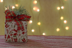 Christmas ornament with gift package and pine branch Stock Photography