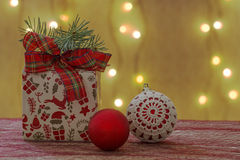 Christmas ornament with gift package and xmas balls Stock Images