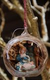 Christmas Ornament. A glass Christmas Ornament with a small nativity scene sold in Napels, Italy Royalty Free Stock Image