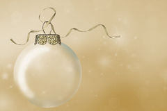Christmas ornament and gold ribbon on bokeh Stock Photos