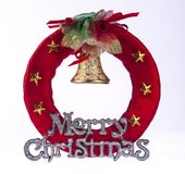 A CHRISTMAS ORNAMENT WITH GOLD STAR AND BELL Stock Photo