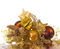 Christmas ornament - golden branch. With baubles, gift box, leaves and other decorations stock images