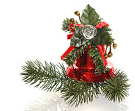 Christmas ornament. A hand bell and a fur-tree bra Stock Images