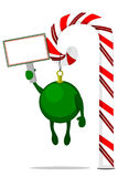 Christmas Ornament hanging from a Candy Cane holding a Blank Sign. Green Christmas Ornament hanging from a Candy Cane holding a Blank Sign against a White Royalty Free Stock Photo