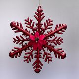 Christmas ornament hanging red ice star with glitter stock images