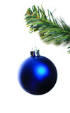 Christmas ornament hanging from a xmas tree branch. Over white background stock photo