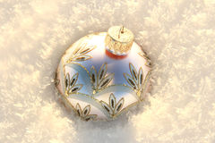 Christmas Ornament. Lavender Christmas ornament in snow stock photo