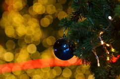 Christmas Ornament. With Lighted Tree in Background Royalty Free Stock Photos