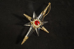 Christmas ornament - North Star, in full. Extraordinary Christmas tree decoration, which could be taken for an antique amulet as well. Cut glass and gold Stock Images