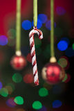 Christmas Ornament over defocused christmas lights Royalty Free Stock Photography
