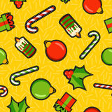 Christmas ornament patch icon pattern background. Christmas seamless pattern background with holiday ornament decoration: bauble, mistletoe, gift box, and candy Royalty Free Stock Images