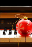 Christmas ornament on piano Stock Photography