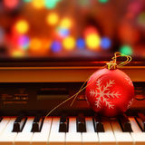 Christmas ornament on piano Royalty Free Stock Photos