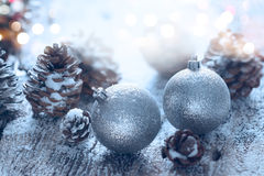 Christmas ornament pine cones; Winter background with frost fir branch Stock Photo