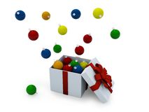 Christmas ornament in a present box. Christmas ornaments jumping out of a present box Royalty Free Stock Image