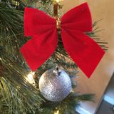 Christmas ornament. Red bow Christmas tree royalty free stock image