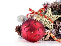 Christmas ornament with red ribbon, pine cones and stock photo