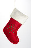 Christmas Ornament Red Stocking. A red, white, and green felt stocking Christmas ornament isolated on white royalty free stock photo