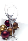 Christmas ornament series. Champagne glasses surrounded by christmas ornaments, isolated on white Royalty Free Stock Image