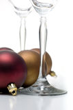 Christmas ornament series. Champagne glasses surrounded by christmas ornaments, isolated on white Royalty Free Stock Photo