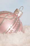 Christmas ornament in the snow Royalty Free Stock Photography
